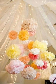The draped tulle with lights behind along with clusters of poms  Accent wall/backdrop idea...