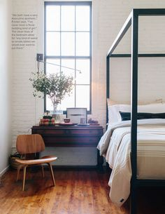stunning space - the tall, whitewashed brick walls, the black painted windowpanes, the sick eames chair (which we own!)