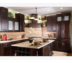 Asian inspired kitchen with dark cherry cabinets creates a modern to transitional look.