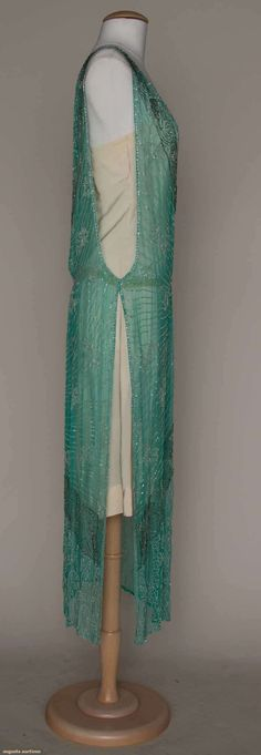 CRYSTAL BEADED PARTY DRESS, MID 1920s Turquoise silk chiffon tabard, crystal bead embroidered botehs, leaves & swirls, on L hip silver bead embroidery in fan & trailing ribbon motif, open sides. Sideway