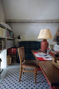 Emma Burns Barn Conversion Guest Annex Library | Real Homes (houseandgarden.co.uk) great lamp/table/chair and of course, the bookcases.