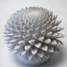 John Edmark (Stanford lecturer, artist) makes sculptures based on math concepts like the Fibonacci sequence