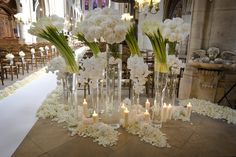 Why we love it: Vary the heights of wedding flower arrangements (from tall calla lily clusters to scattered petals along the aisle runner) to create an eye-catching display fitting a formal wedding. Photo by: Bob and Dawn Davis Wedding Ceremony Ideas, Church Wedding Flowers, Church Wedding Decorations, Wedding Centerpieces, Wedding Ceremonies, Wedding Stage, Wedding Reception, Modern Flower Arrangements, Wedding Flower Arrangements