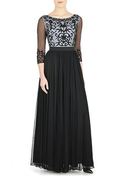 Intricate flourishes embroidered over a contrast bateau-neck bodice add modern graphic styling to our timeless dress while a banded waist defines the cinched waist and the gossamer mesh skirt flares into a dramatic A-line silhouette.