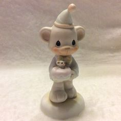 A personal favorite from my Etsy shop https://www.etsy.com/listing/466667079/enesco-precious-moments-birthday-bear