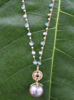 """""""Bliss"""" Blue Diamond Encrusted Flower. love this necklace."""
