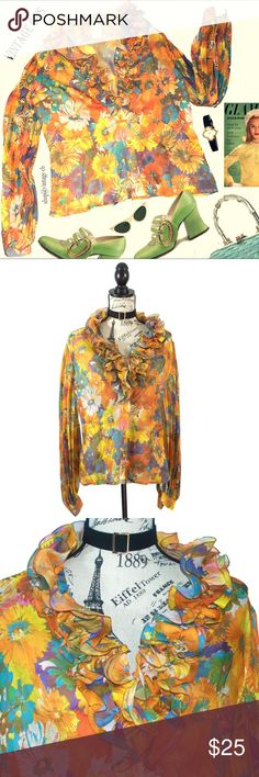 """Vtg 60's Shear Ruffle Flower Long Sleeve Blouse Beautiful Vintage, I would say from the 60's Shear Flowery Blouse with contrasting buttons and ruffles on collar and pleated Bellowing sleeves with cuffs.  I found this at a Berlin, Germany Store and its absolutely beautiful.  It is in excellent condition, it is missing one button on the cuff, but can be easily replaced with a new button.  Perfect blouse for Spring!  Size:  European 44 (US Size: 10) Chest:  42"""" Waist:  38"""" Length:  24"""" Sleeve…"""