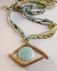 Blue eye, flat, driftwood and amazonite on silk yarn