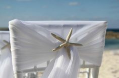 Starfish pinned flowing fabric in place for this beach wedding. As designed by Wildflowers Bahamas. xxVP #DestinationWedding #Bahamas