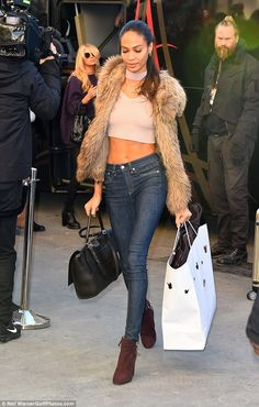 Top of the crops: Joan Smalls sported a pink top and slim fitting jeans as she arrived at The Grand Palais in Paris ahead of the Victoria Secret Fashion Show on Wednesday