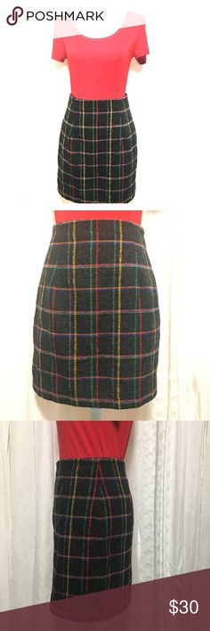 Express vintage pencil skirt size 7 Adorable vintage plaid skirt. Zippers and buttons in back, is fully lined. Wasted 13.5 inches 18 length 18 inches 65% acrylic  15% wool 15% polyester 5% rayon This is an adorable vintage skirt in amazing condition. Would be the perfect piece to add to your wardrobe this fall! Thanks for visiting my closet feel free to look around! Skirts Pencil