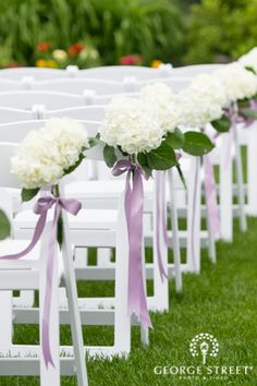 Gorgeous white and and lavender aisle decor. Hydrangeas always steal our hearts!