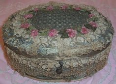 Very old French textile sewing or boudoir storage box dating to the early 1900s. It is made from heavy cardboard and covered in various types of