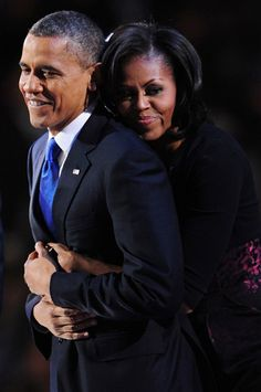 """Michelle hugs her husband President Barack Obama as if to say """"I love you and have your back""""."""