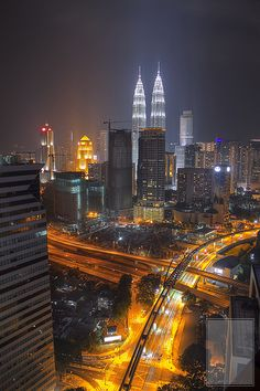 Kuala Lumpur Cityscape at Night.  Ultra modern infrastructure!  ASPEN CREEK TRAVEL - karen@aspencreektravel.com