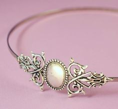 Like this one, not sure about all the metal or how we could make it.    Victorian headband filigree silver antique style.