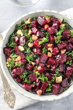 This kale and beet salad is chock-full of healthy nutrients. It's made with super foods such as beets, kale, walnuts, garlic, and olive oil.
