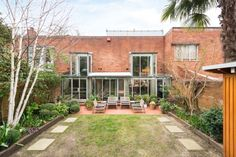 A mews house, which was an early project by two of the world's leading architects, has come on the market on what is arguably the most impressive street in Camden for Modern architecture. Mews House, Camden, Modern Architecture, 1960s, Contrast, Houses, Patio, World, Outdoor Decor