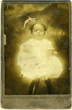 vintage cabinet card of baby - almost looks ethereal - love the aged look