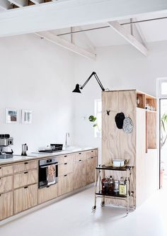 Truly inspired design hacks have turned this small urban apartment in Cape Town into an expansive work-eat-sleep-play zone that belies its 58-sqm footprint.