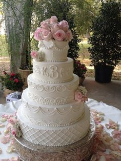 Modern vintage — Round Wedding Cakes - with scrollwork. Different flowers and color scheme, but I like the details