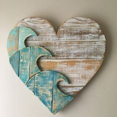 Our blue wave heart, created from our own design and crafted with reclaimed lumber. Each board is carefully chosen and hand sanded. The shapes are cut out, painted and then sanded again before assembly. The heart is assembled with both wood glue and nails Arte Pallet, Pallet Art, Diy Pallet, Beach Wood, Beach Art, Deco Surf, Reclaimed Lumber, Beach Signs, Beach Crafts
