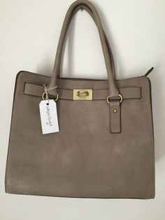 Very nice bag with zipper closure, many compartments for storage and is deep.