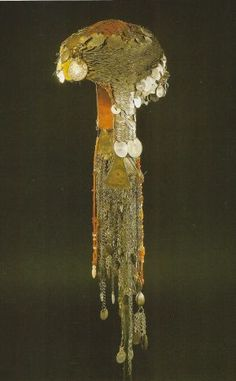 Headdress from Samu'ah in the southern Hebron hills, dating from the 1840s but with later additions.In the nineteenth century, Palestinian women in some areas wore a bonnet to which coins were attached. Part of a girl's bridal jewellery, they belonged entirely to her and could not be touched by her husband