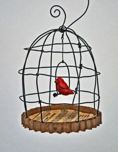 Birdcage with sculpy made bird and old tin