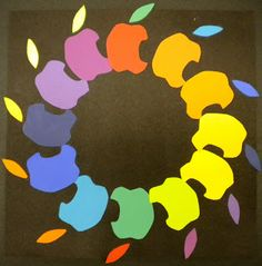 Kids create their own personal symbol color wheel.They choose one symbol that represents themselves, create one stencil, and use that stencil to cut it in each of the 12 color color wheel. Good project that will take lots of time!