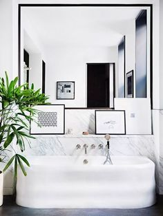 Modern bathroom with marble wall and white bathtub