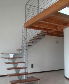 Escalera en L con zanca central (estructura metálica y peldaños de madera) STM 07 RIZZI