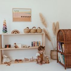 Kids room - That wicker shelf, that pampas grass, that tiny top knot 😍 Mini marble trees, round wooden stackers and mini bolga baskets all in store… Girl Nursery, Girl Room, Baby Room, Nursery Decor, Nursery Ideas, Playroom Montessori, Waldorf Playroom, Room Deco, Wicker Shelf