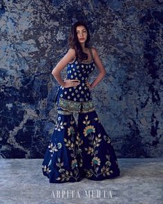 Are you looking for a unique styled lehenga for the upcoming wedding season? Check out Arpita Mehta's shells on lehenga blouse style in this post. Indian Gowns Dresses, Indian Fashion Dresses, Dress Indian Style, Indian Designer Outfits, Pakistani Dresses, Indian Wedding Outfits, Bridal Outfits, Indian Outfits, Sharara Designs
