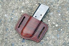 Belt pouch for your spare 1911 magazine. Hand made from 6-7oz vegetable tanned cowhide. Chestnut brown dyed. For right hand users, mag is carried Iphone Holster, Strong Hand, Belt Pouch, Thick Leather, Concealed Carry, Concealment Holsters, 1911 Grips, Brown, Unique Jewelry