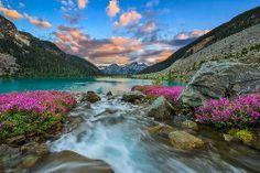 A stream feeding a clear mountain lake