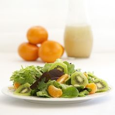 You will love this salad...it is light, sweet, refreshing and perfect for spring. The combination of kiwifruit, orange and almonds is perfectly balanced on a bed of spring mix salad.