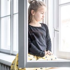 The smell outside the window? Spring !!  #spring#window#little#girl#looking#smell#outside#acorn#print#cotton#skirt#kids#kidsfashion#yellow#pantone#ju  photo by wojtekradwanski.com