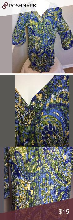 Catherine's 14/16 paisley stain glass crinkle top CATHERINES gorgeous blue, yellow, green, black, and white paisley stained glass print crinkle Blouse. Y-neckline with metallic necklace detail, artsy two point sharkbite hem, 3/4 sleeves. 100% polyester, machine wash. Excellent condition with no noted flaws or signs of wear. Tagged Size 0X, please check pictures for measurements to determine fit. Measurements are laying flat UNstretched.   Smoke free environment, Thanks for looking…
