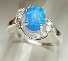 Fire Blue Opal ring - Someday I will have a ring like this!! #opalsaustralia