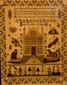 This is a lovely English sampler from Oxfordshire. Complete with cat and dog