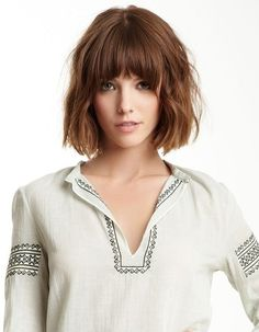 Tousled Curly Bob Hairstyle with Blunt Fringe