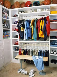 Have Fun with Storage - Make it fun to stay organized. Treat kids' closets to practical touches that mimic their room's decorating theme or play to their favorite interests. This young sports fan, for instance, has room in his walk-in closet to display favorite ball caps. A decorative border of helmets and balls lines the ceiling. And he can even change sneakers on a locker room-style bench. Be creative and play up the theme, installing a basketball hoop above a clothes hamper, for example.