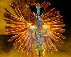 Thousand-Hand Bodhisattva Chinese Dance    This amazing video shows the Thousand-Hand Dance which includes 21 hearing impaired Chinese performers at the 2005 CCTV Spring Festival.  http://www.weirdasianews.com/2007/10/18/thousand-hand-bodhisattva-chinese-dance/