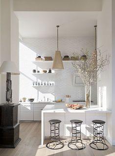 Sunny, white kitchen