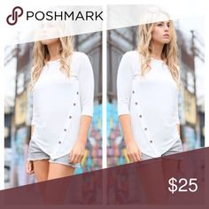 White Top with Buttons Three quarter sleeve top. Trendy button detail. No trades and no holds. Happy Shopping 😃 Tops