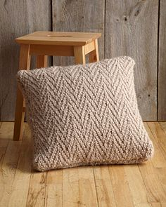 Herringbone Stitch Pillow in Lion Brand Wool-Ease Thick & Quick, a beautiful pattern for your cozy home. Find this pattern and more inspiration at LoveKnitting.Co!