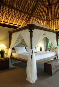 Each of the standalone villas feature traditional thatched roofs, dreamy four-poster beds and luxurious linens. Bali Bedroom, Bedroom Sets, Master Bedroom, Bedroom Decor, Bedding Sets, Bedrooms, Home Decor Furniture, Furniture Design, Suites