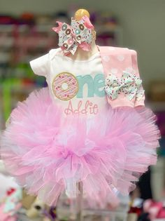 """""""Donut Grow Up"""" Baby girl First Birthday tutu outfit. Set includes:Bodysuit with name (leave note at checkout)TutuLeg WarmersBunny bow/headband First Birthday Theme Girl, 1st Birthday Girl Decorations, Donut Birthday Parties, Baby Girl 1st Birthday, Birthday Ideas, Donut Party, 1st Birthday Outfits, Princess Birthday, Birthday Celebration"""