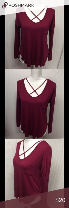 """""""be your own kind of Beautiful"""" by belle du jour """"be your own king of Beautiful"""" by belle du jour ... raspberry color, criss cross front with pouch pocket on left crest ... flows effortlessly on and very comfortable wear-now top! Bought new! Never worn! Too big for me now! Belle Du Jour Tops"""